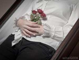 woman-hands-in-coffin.jpg